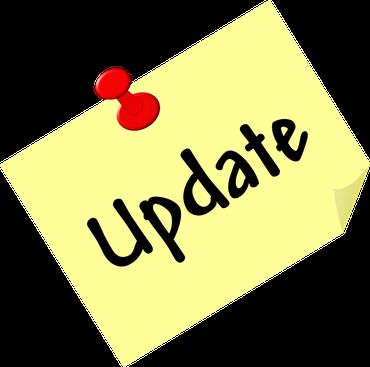 """Ein gelber Notizzettel, auf dem das Wort """"Update"""" steht und der mit einer roten Stecknadel befestigt ist"""